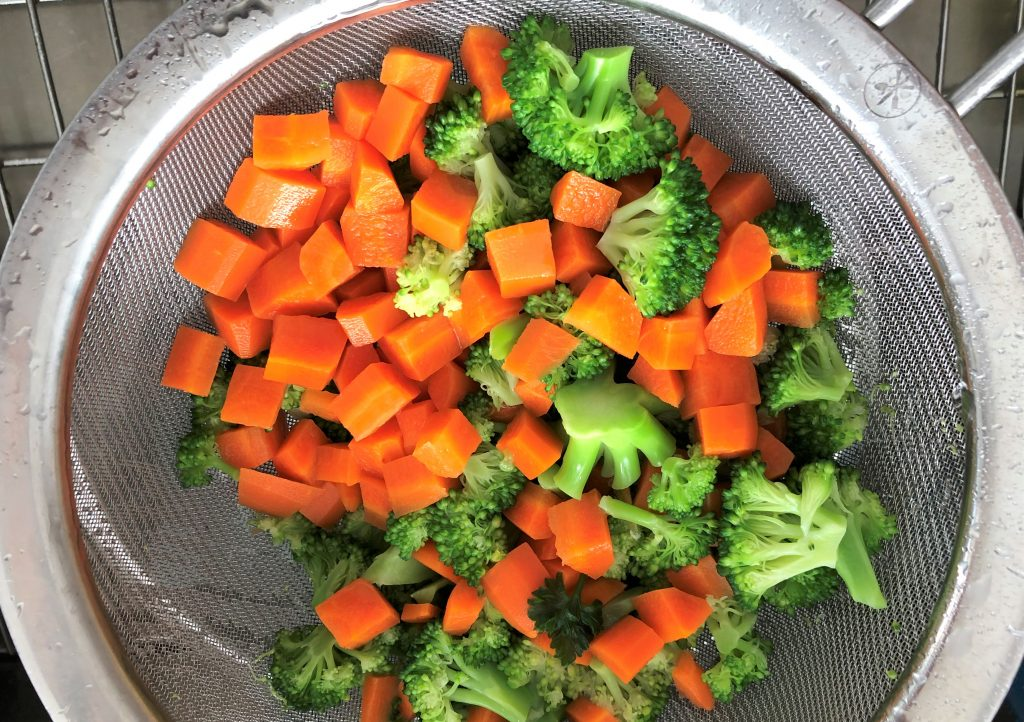 strained chopped broccoli and carrots